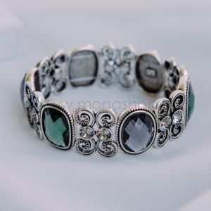 Браслет «Драконий камень» с крупными серыми и зелеными камнями