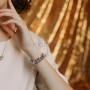 Браслет «Улыбка» с подвесками и белыми кристаллами